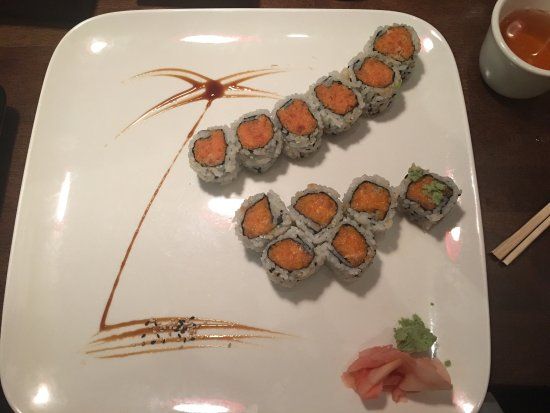 Azan Wok: I had to post this with such a nice portrait on the plate. Spicy salmon and spicy tuna rolls....