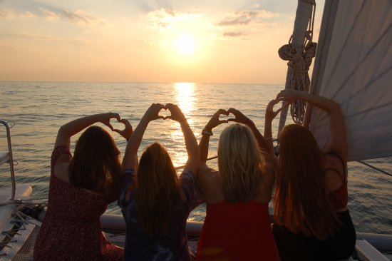 South Haven, MI: Showing their LOVE for sailing at sunset on Cat's Meow Cruises.