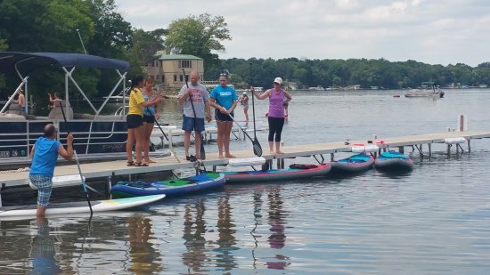 Oconomowoc, WI: A group of paddlers listening to some instruction before heading out.