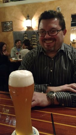 Bristol, RI: Claus enjoys a well poured Weihenstephaner at Redlefsen's