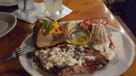 Pearl City, HI: 16 oz. Ribeye and Blue Cheese Butter plus a Lobster Tail with drawn butter with a Loaded Potato