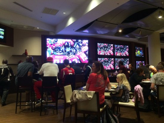 Champions Sports Bar : Yelling at a game we have no idea about!!