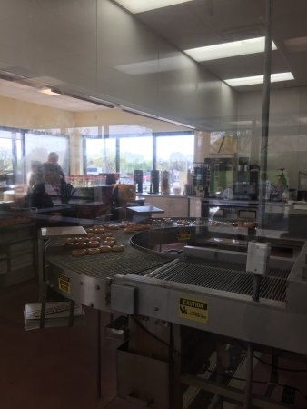 Clive, IA: Cooking donuts at Krispy Kreme this morning.