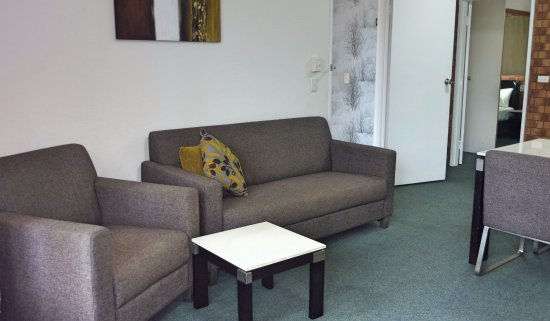 Labrador, Australia: One bedroom apartment - Well appointed seating in lounge area