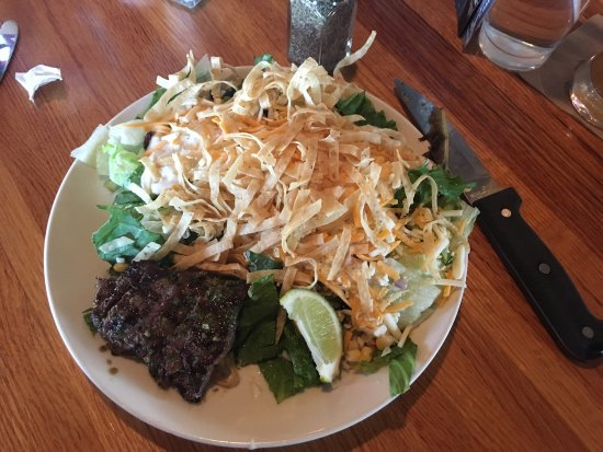 Galesburg, IL: Their beer on tap is flat. My steak salad was 90% watery lettuce. See pic. The waitress had the