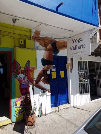 Yoga Vallarta: Sidewalk view of our main entrance to our yoga studio. Go through blue doors up to 3rd floor.