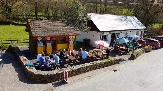 Withypool, UK: Customers enjoying cream teas in the sun