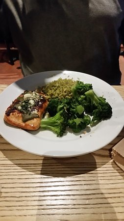 Dulles, VA: Ancho Salmon served with rice & steamed broccoli.