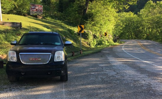 Jasper, AR: Parking (if you can find any) feet from a busy blind curve. Various debris in disrepair surround