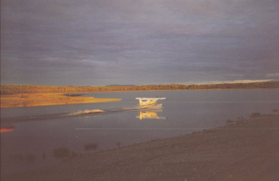 Bettles, AK: Float plane rides from the Lodge--another lands at sunset