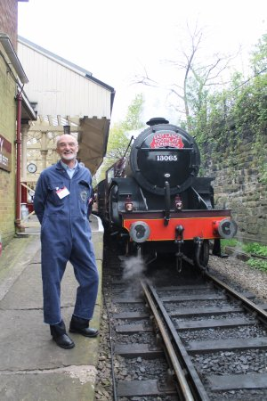 Bury, UK: Learner driver with a LMS 'CRAB' 2-6-0 locomotive