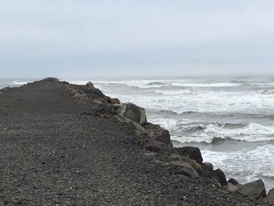 Ilwaco, WA: North jetty going out into Pacific - dangerous waves can crash over top.