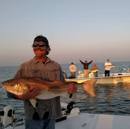 Cape Fear, NC: Captain Jeff and Captain Christian on a large school of Fall Bull Redfish