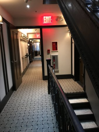 The Evelyn: Looking down the hall the cast iron stairs so NYC.