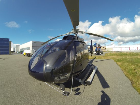 Sola Municipality, Norway: Helitrans EC130T2 Eco Star outside view, with flotation gear for your safety