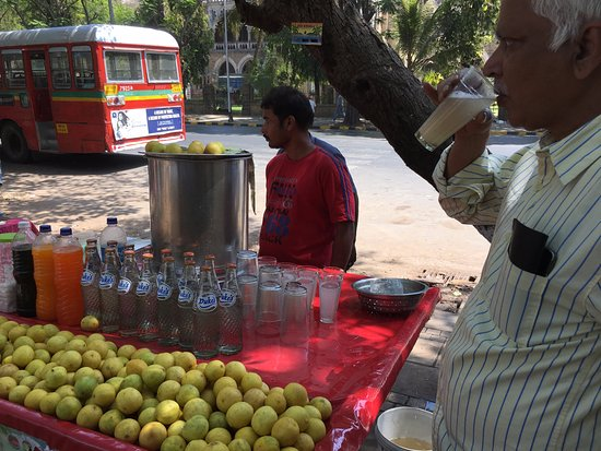 Guide getting juice across street from Bombay High Court