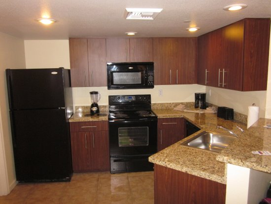 Kitchen in unit 1009A. Dated look and appliances, but very clean ...