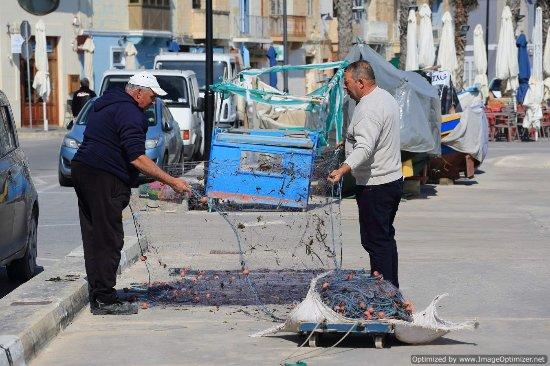 Marsaxlokk, Malta: sorting their nets