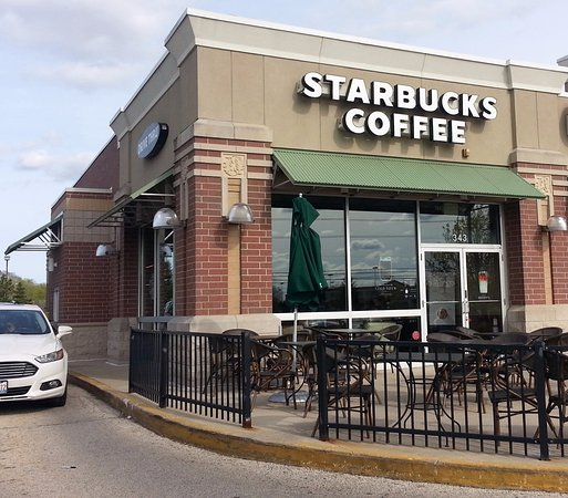 front of, drive-thru, patio & entrance to Starbucks Coffee ...
