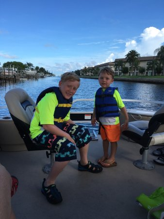 New Port Richey, FL: Our sons and my husband ready to head out of the channel and into open water. We had dolphins fo