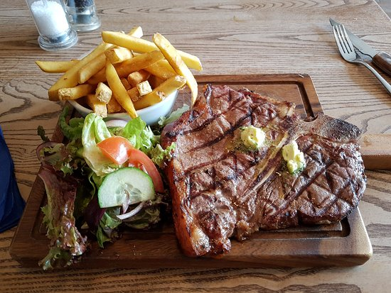 Charlton Kings, UK: T Bone Steak with Garlic Butter, fries and salad