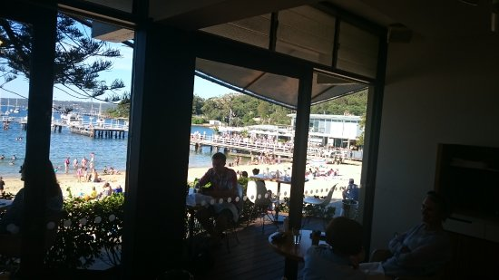 The Public Dining Room: The view from the restaurant to the beach, our table was the empty one at the end of the patio