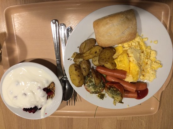 Vantaa, Finland: Breakfast - Eggs, sausages, bread, potatoes, tomatoes (with pesto), and cereal.