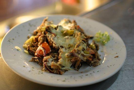 Julich, Germany: Gyros Spezial, die Mediterrane Kombination.  Überbackenes Gyros mit Feta, Zwiebel, Peperoni, und