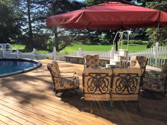 Williamston, MI: poolside seating area with fire pit