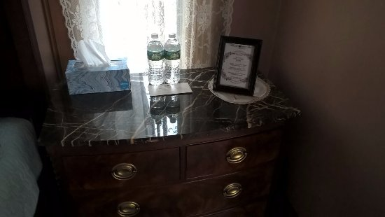 Tilton, NH: One of two nightstands. Notice the wifi info in the picture frame.