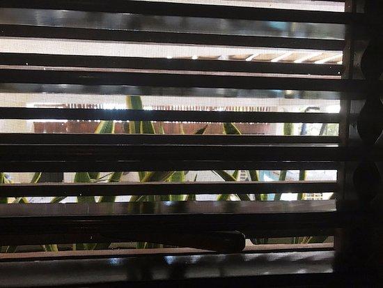 Mezzanine Colibri Boutique Hotel: the sole window, next to the shower. A/C unit right outside.