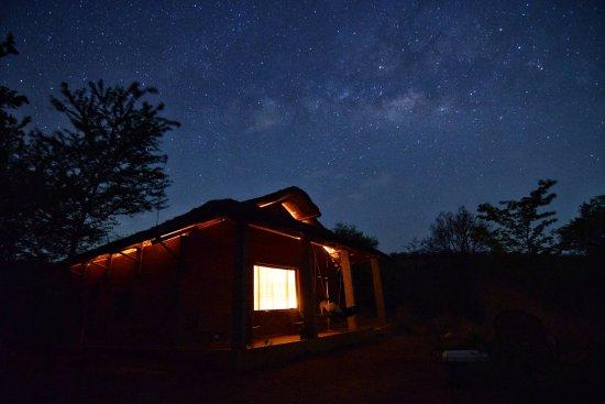 Krishnagiri, India: Milkyway rising above the cottage