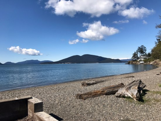 Anacortes, WA: Looking across the Guemes Channel from the beach near the Washington Park boat launch on a sunny