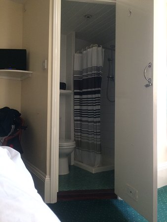 Thanet Hotel: The shower room is very small and almost at the foot of the bed. The light shades were stained a