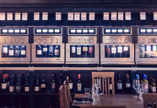 "Buellton, CA: Our famous ""Wine Wall"" with 52 wines by the taste, half glass or full glass."