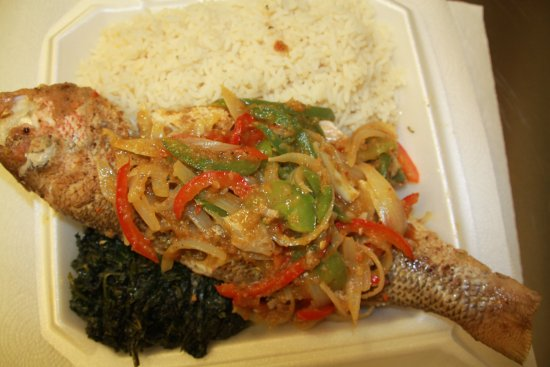 Lawrenceville, GA: Steamed and garnish  Red Snapper with rice and spinach