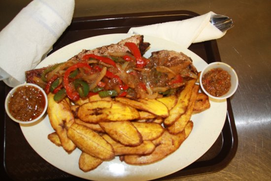 Lawrenceville, GA: Garnished Red Snapper with plantain and sweet sauce