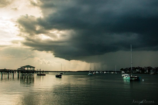 Folly Beach, SC: Storm coming at the Folly River Boat Landing.  Sail Folly's 27' Stiletto Catamaran is in the rig