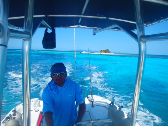 West End, Honduras: Capt. Arturo with Pigeon Cay in the background