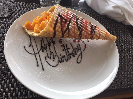 Courtyard Ahmedabad: Yummy Waffle cone infused with mango mousse , cream and fresh mangoes