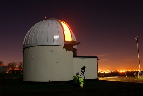 Sutton in Ashfield, UK: The observatory lit by the full moon with the inside lights on for added effect