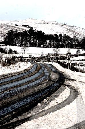 The road outside Laggan Parish Church graveyard - winter