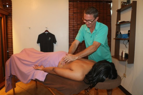 Road Town, Tortola: Doug massaging client at Main Street location