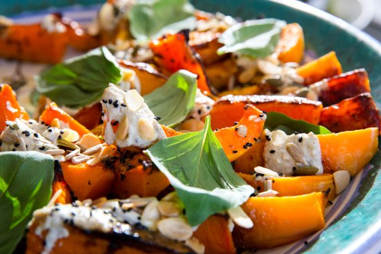 Thame, UK: Roast butternut with burnt aubergine, yoghurt, toasted seeds and basil, ready for lunch