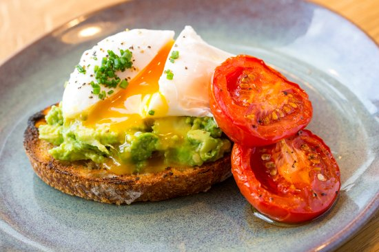 Thame, UK: Crushed avocado on sourdough toast, poached egg and slow roast plum tomatoes. Best brunch in Tha