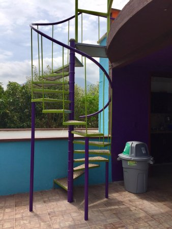 Magdalena Department, Colombia: Colorful stairs leading to rooftop.
