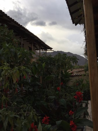 El Albergue Ollantaytambo: View from the stoop of our room, the garden between the buildings.