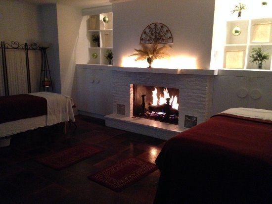 Lake Geneva, WI: Cozy up by the fire!  This room can accommodate a couples massage or a group of 8 of your friend