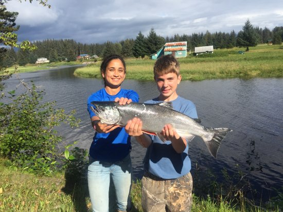 Gustavus, AK: Wilson, a young anger, learned how to cast and caught a beautiful Coho Salmon all in the same da