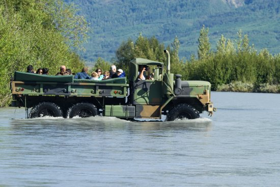 Knik Glacier Tours: River crossing in one of the deuce and a half 6x6